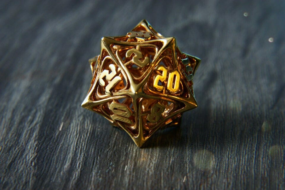This spiky d20 has been made from 14 karat gold.